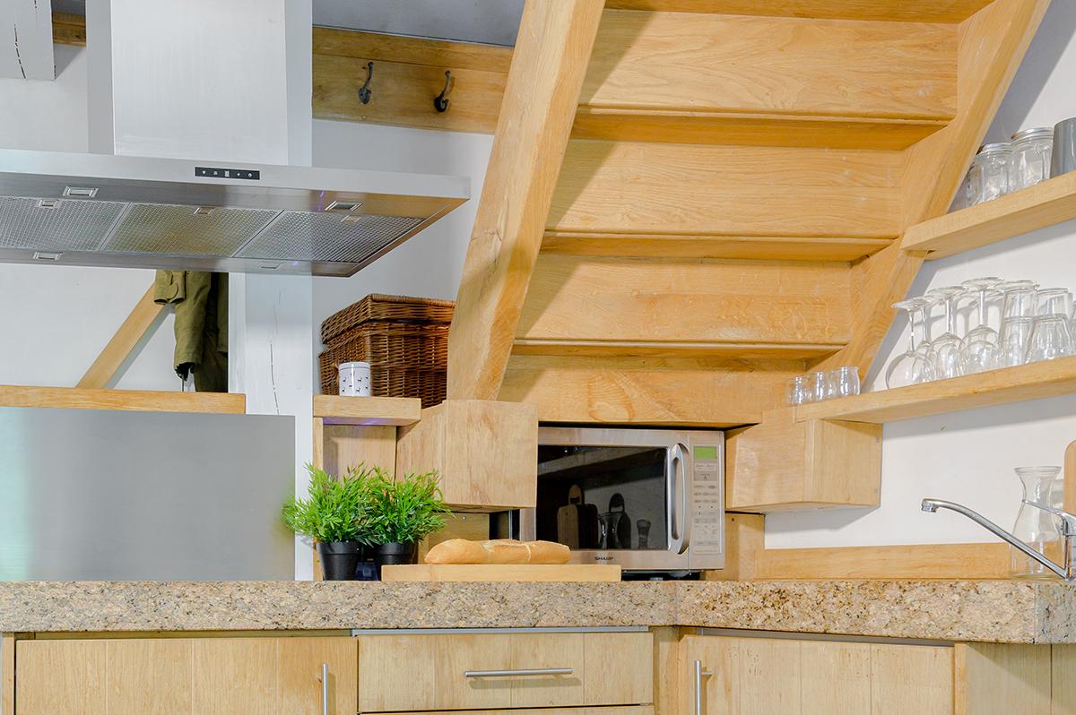 Vakantiehuis Murol met open keuken en luxe combi oven
