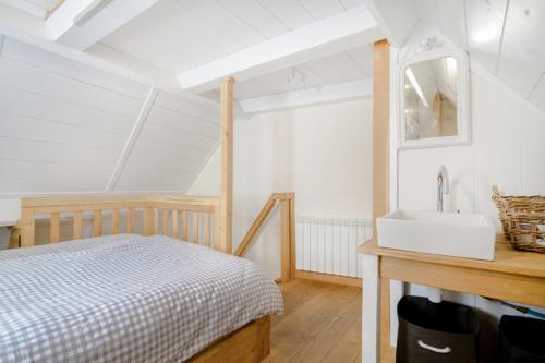 De slaapkamer van het vakantiehuis Murol